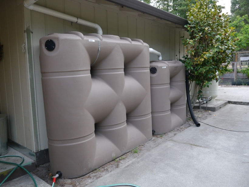 Two more of the large, slimline tanks. These are under the back eave of our garage.