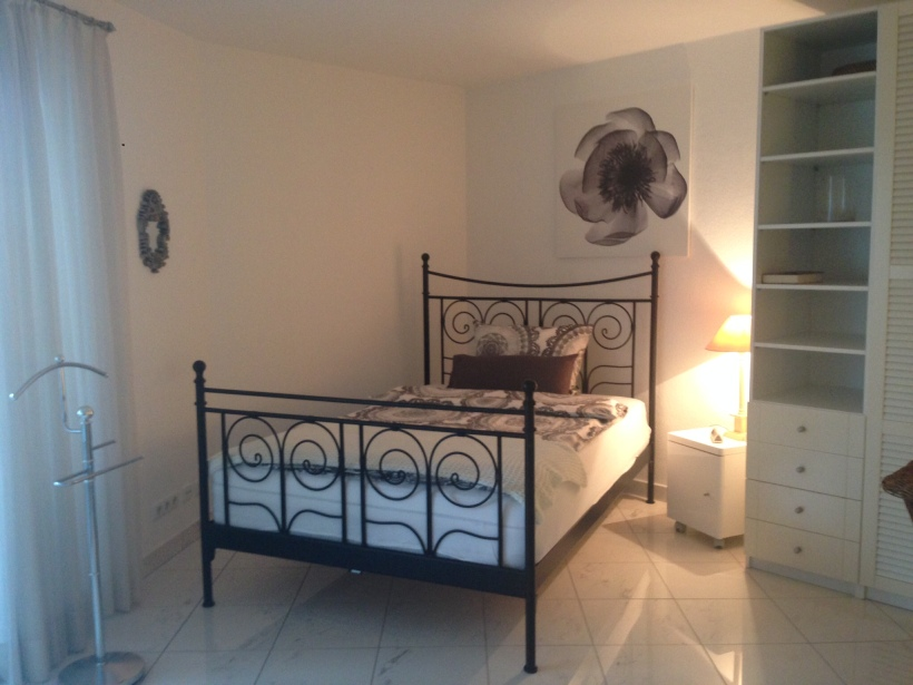 A full size bed, in the main living area